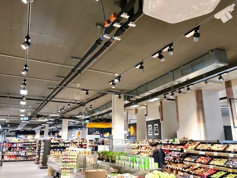 Innenansicht Supermarkt im Neubau Wormser Hof Heidelberg
